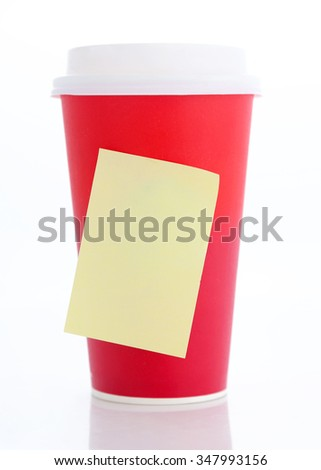 Coffee to go. Paper coffee cup with blank yellow stick note - stock photo