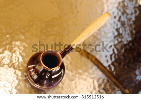 Coffee turk on the table in cafe or coffee shop. Brown caffeine drink. Aroma hot black espresso, cappuccino with foam on breakfast in the morning in restaurant. Background with fresh latte.  - stock photo