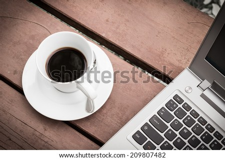 Coffee with a notebook and a job to do. - stock photo