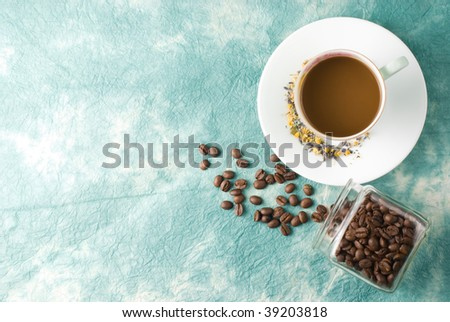Coffee with beans in glass jar on special retro background
