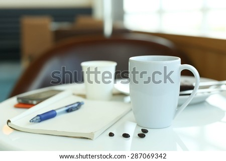 Coffee with blank paper note and pen