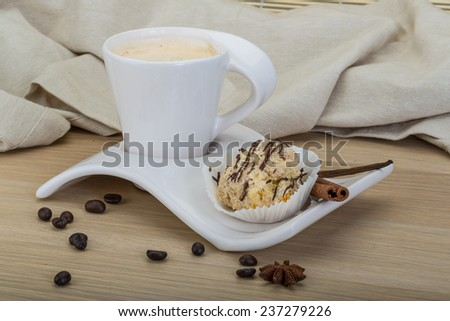 Coffee with cake served beans and cinnamon - stock photo
