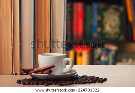 Coffee with cinnamon on a bookshelf