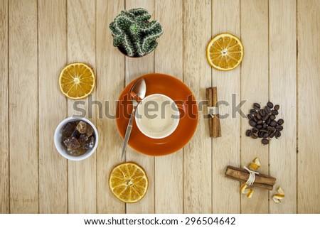 coffee with cinnamon, orange and sugar - stock photo