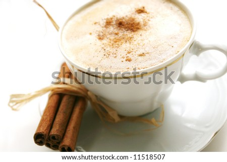 coffee with cinnamon stick - stock photo