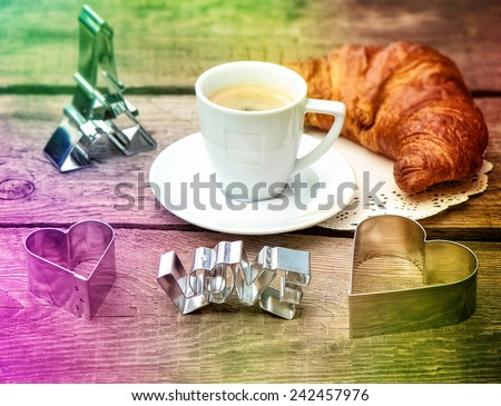 Coffee with croissant and heart decoration. Romantic Valentine's Day breakfast with deco symbol of paris eiffel tower. Retro style colored picture - stock photo