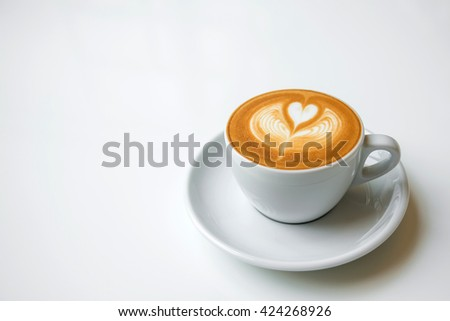 coffee with heart pattern in a white cup - stock photo