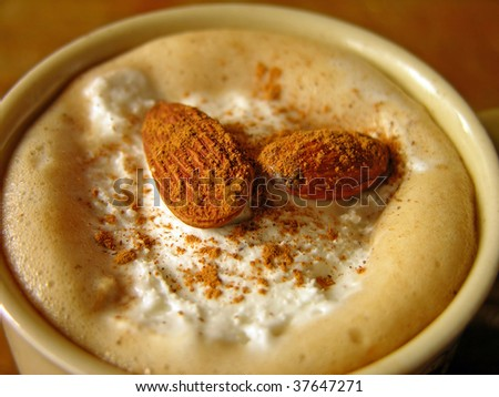 Coffee with ice-cream, almonds and cinnamon - stock photo