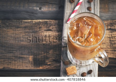 Coffee with ice in a glass, selective focus, top view, space for text, tinted - stock photo