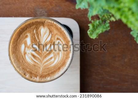 Coffee with latte art - stock photo