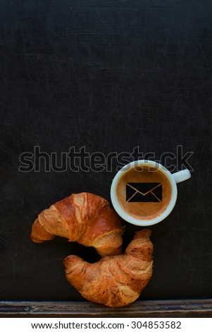 coffee with mail sign and croissant at board - stock photo