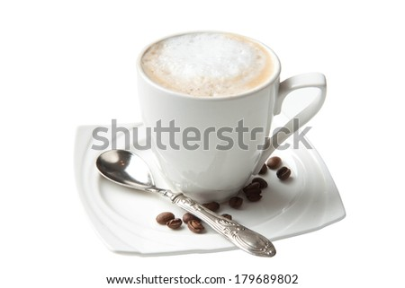 Coffee with milk served in a white cup with coffee beans on a side - stock photo