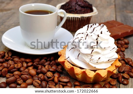 coffee with muffin, cake and chocolate - stock photo