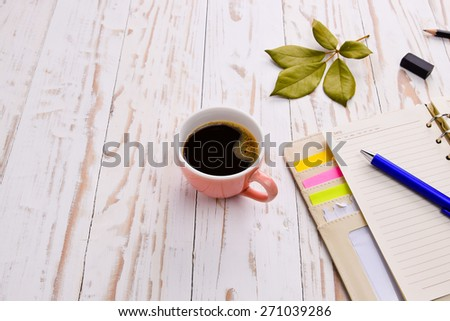 Coffee with notepad and pen on old white wooden table.with copy space - stock photo