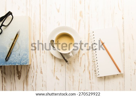 Coffee with notepad and pencil,concept for  working on morning time(warm tone) - stock photo