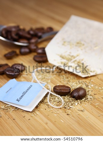 coffeebeans and camille tea - stock photo