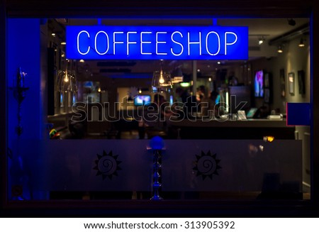 Coffeeshop neon signboard at night. Eindhoven, Netherlands - stock photo