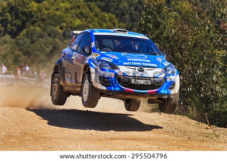 COFFS HARBOUR, AUSTRALIA - SEPTEMBER 14, 2014: Australian crew B. Reeves World Rally in a Mazda 2 RS WRC 2014 race super stage during Australian World Rally Championship - stock photo