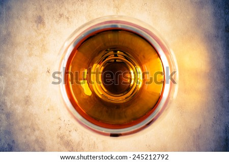 Cognac, brandy in the glass top view - stock photo