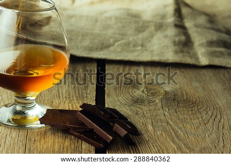 Cognac glass and chocolate horizontal selective focus copy space