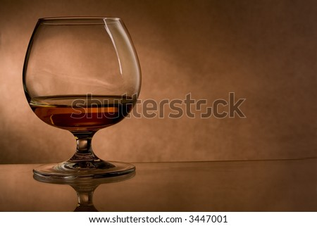 cognac glass on vintage background - stock photo