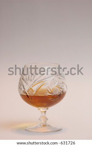 Cognac in a crystal sifter - stock photo