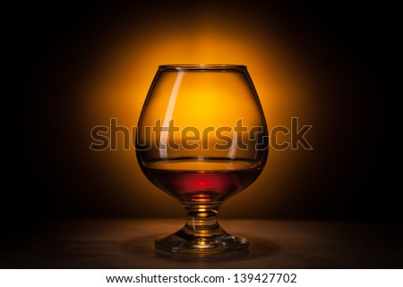cognac in fancy glass, with reflection - stock photo