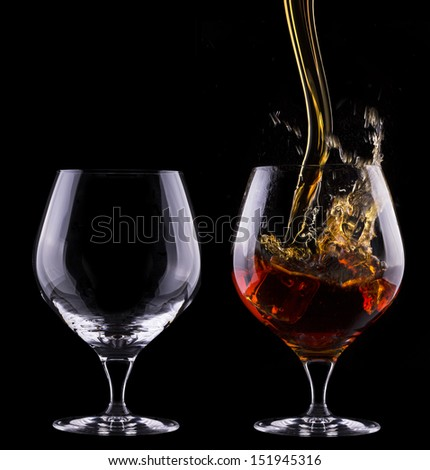 Cognac or brandy full and empty glass  set on a  black background