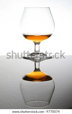 cognac sniffer with reflection - stock photo