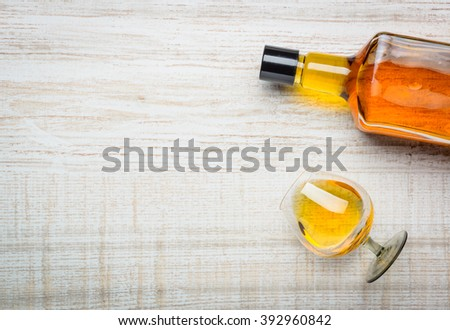 Cognac Stron Brandy Bottle and Glass with copy space - stock photo