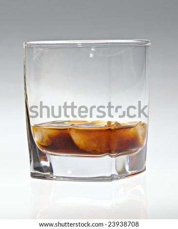 Cognac with melt ice - stock photo