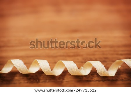 coil like wood curl on rustic wood. shallow depth of field.  - stock photo