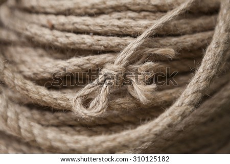 Coil of rope with marine knot loop. Roll of ship ropes as background texture - stock photo