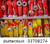 Coiled red and yellow fire hoses. - stock photo