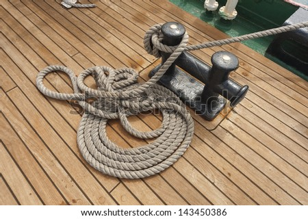Coiled rope on boat's deck - stock photo