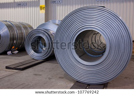 Coils of stell stripes in store - stock photo