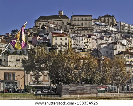 COIMBRA, PORTUGAL - DECEMBER 2. General view with a city flag on December 2, 2012 in Coimbra, Portugal. Ancient capital citu of Portugal before que conquest of Lisbon. 150,000 population. - stock photo