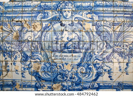 "COIMBRA, PORTUGAL - JULY 31, 2016: Azulejo tilework in Coimbra, Portugal, depicting ""I sleep and my heart guards me"""