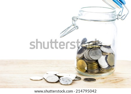coin in glass jars - stock photo