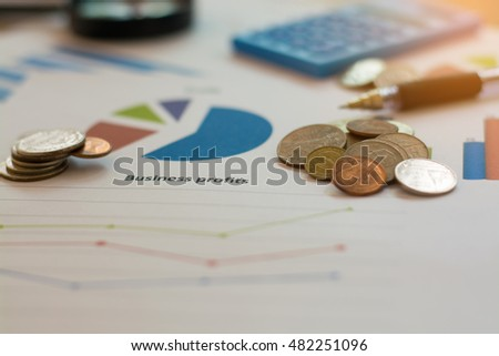 Coin on graph chart, Finance concept