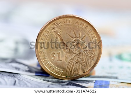 coin one dollar against the background US dollars background - stock photo