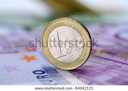 coin one euro at EUR 500 banknotes - stock photo
