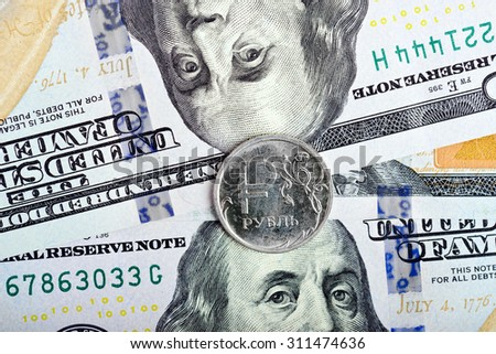 coin one ruble against the background US dollars background - stock photo