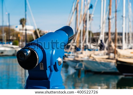 coin operated binocular at barcelona harbour - stock photo