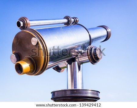 coin-operated binoculars in front of blue sky - stock photo
