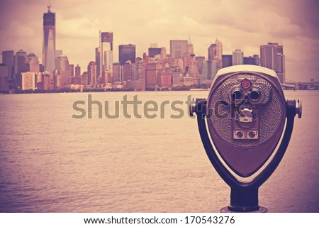 Coin operated binoculars with Lower Manhattan on the background (New York City). Nashville effect picture. - stock photo