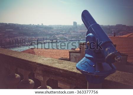 Coin operated telescope in Porto. - stock photo