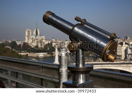 Coin operated telescope looking at Notre-Dame Cathedral in Paris - stock photo