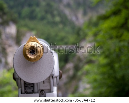 Coin operated Telescope with one eyepiece, pointed towards the mountains of Bavaria, Germany. - stock photo