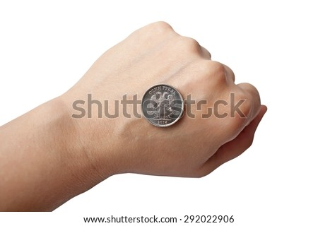 Coin 1 ruble is an eagle up on the back of her hand, balled into a fist - stock photo